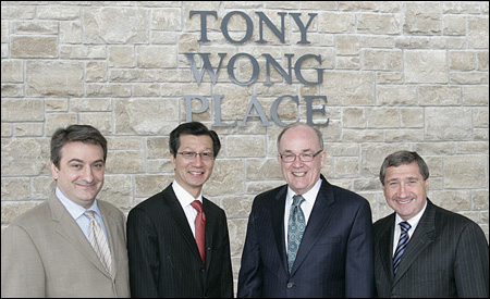 February 25, 2011 — (from left to right) Paul Calandra, MP for Oak Ridges – Markham; Michael Chan, MPP for Markham – Unionville and Minister of Tourism and Culture; Gordon Landon, Regional Councillor, Town of Markham; and Bill Fisch, York Regional Chairman and CEO, celebrate the grand opening of Tony Wong Place in Markham.