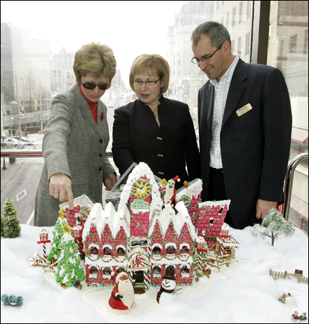 Diane Finley, Minister responsible for Human Resources and Skills Development (from left), CMHC President Karen Kinsley and Marc Caron, Vice-President of Habitat for Humanity NCR's Board of Directors, at the Rideau Centre in Ottawa, Friday, November 21, 2008, view an entry at CMHC's 7th annual charity Gingerbread House competition for Habitat for Humanity.