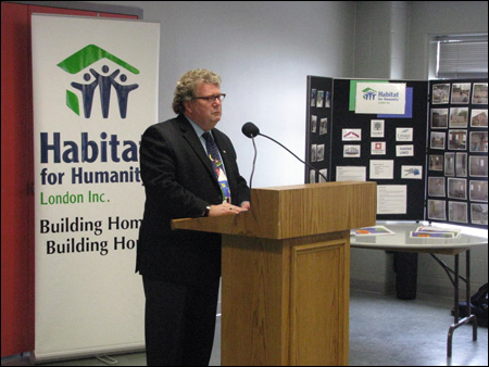 Ed Holder, Member of Parliament for London West speaking at Habitat for Humanity London's Egerton Street dedication ceremony.