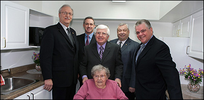 From left to right: Niilo Saari, past President of Finnlandia Village, Steve Jacques, Manager of Community Development, Ontario Region, Canada Mortgage and Housing Corporation, the Honourable Rick Bartolucci, MPP for Sudbury, Ron Dupuis, Ward 5 Councillor, Brian Koivu, President of Finnlandia Village, and Meta Otto, resident of Finnlandia Village (front row), celebrate the official announcement of more than $9.4 million in federal-provincial social housing funding for Greater Sudbury.