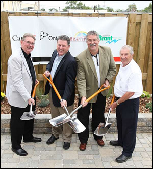 (from L to R) Mike Hancock, Mayor of Brantford; Phil McColeman, Member of Parliament for Brant; Dave Levac, Member of Provincial Parliament for Brant; and Ron Eddy, Mayor of Brant County; celebrate the official opening of four affordable housing projects and the start of construction of four affordable housing projects in Brantford and Brant County on September 11, 2009.